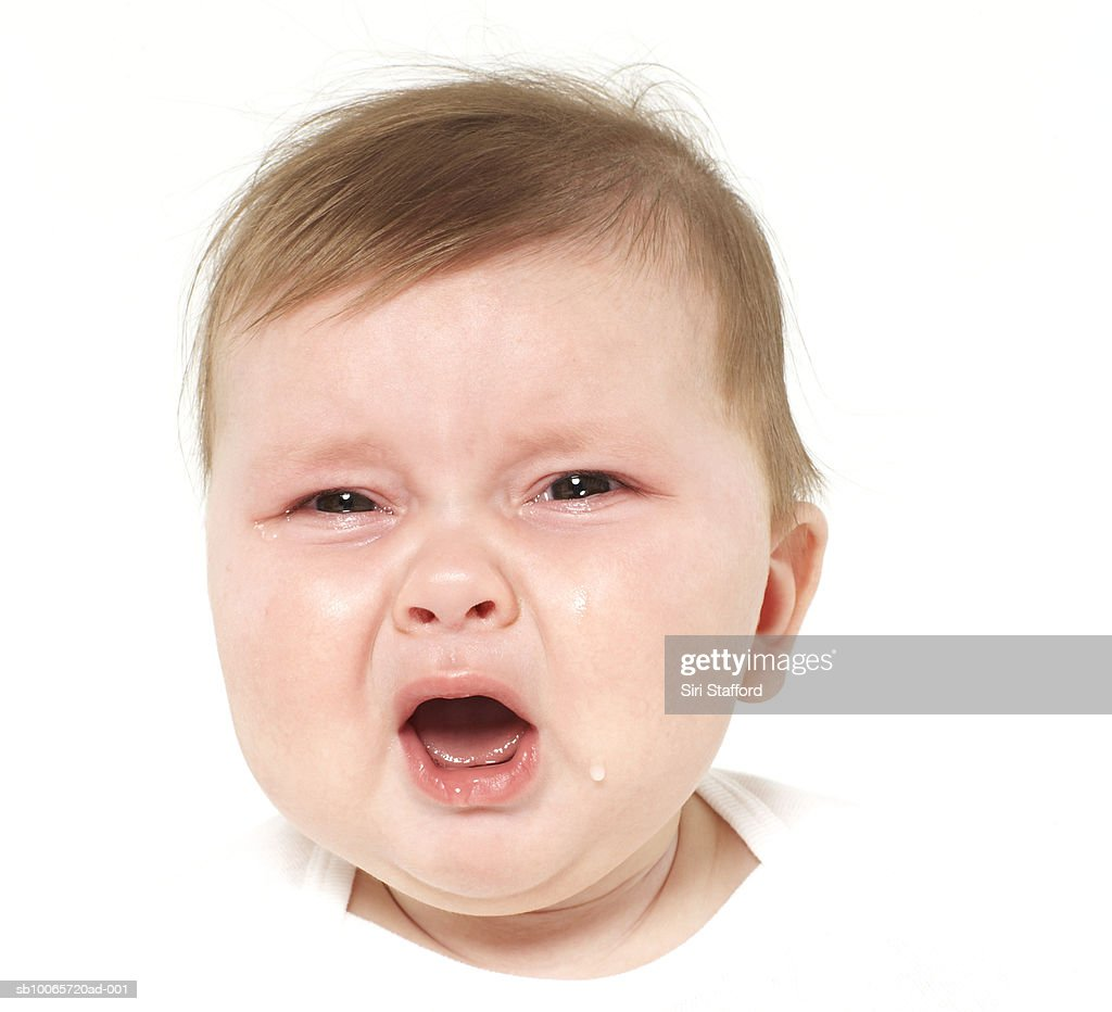 Baby boy (6-9 months) crying, portrait, close-up : Stock Photo