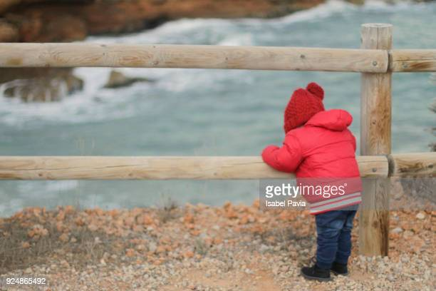 Baby boy discovering the sea
