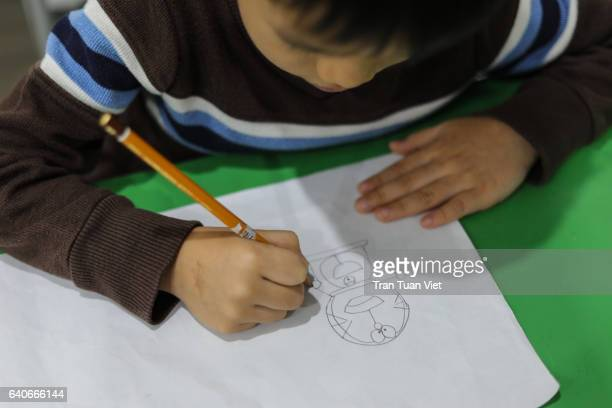 baby boy drawing on paper - pencil drawing stock pictures, royalty-free photos & images