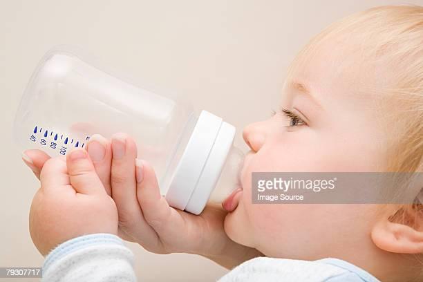 Baby boy drinking from bottle