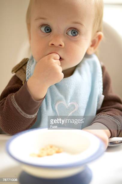 Baby Boy Eating in Highchair