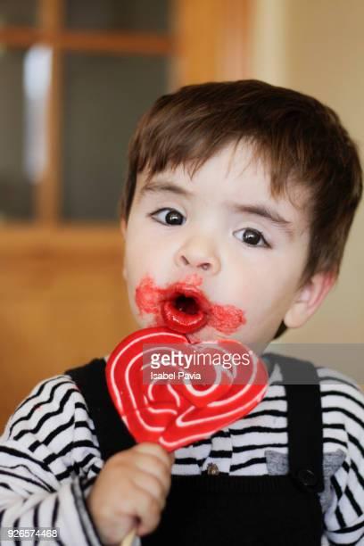 Baby boy eating lollipop