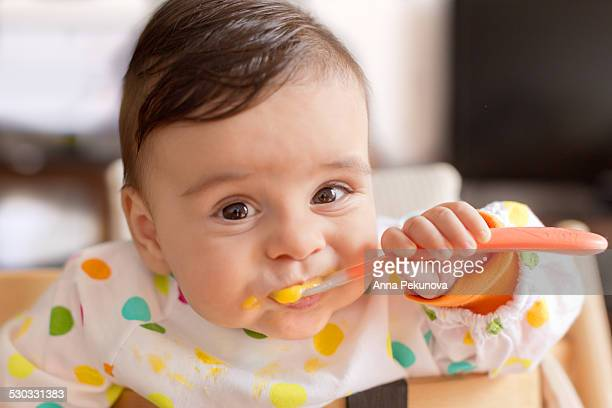 baby boy eating pureed food - pureed stock pictures, royalty-free photos & images