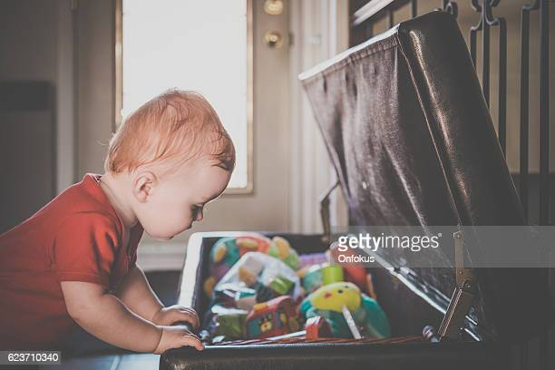 Baby Boy Exploring and Looking Inside Toy Box