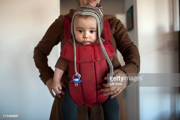 baby boy facing forward in a baby carrier