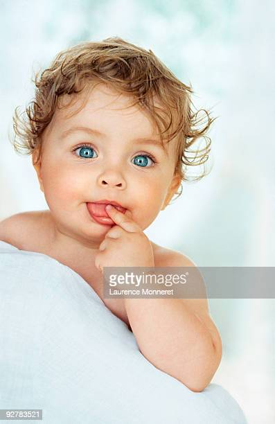 baby boy finger on tongue looking questioningly - under tongue stock pictures, royalty-free photos & images