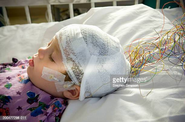baby boy (15-18 months) having eeg test, close-up, side view - eeg stock pictures, royalty-free photos & images
