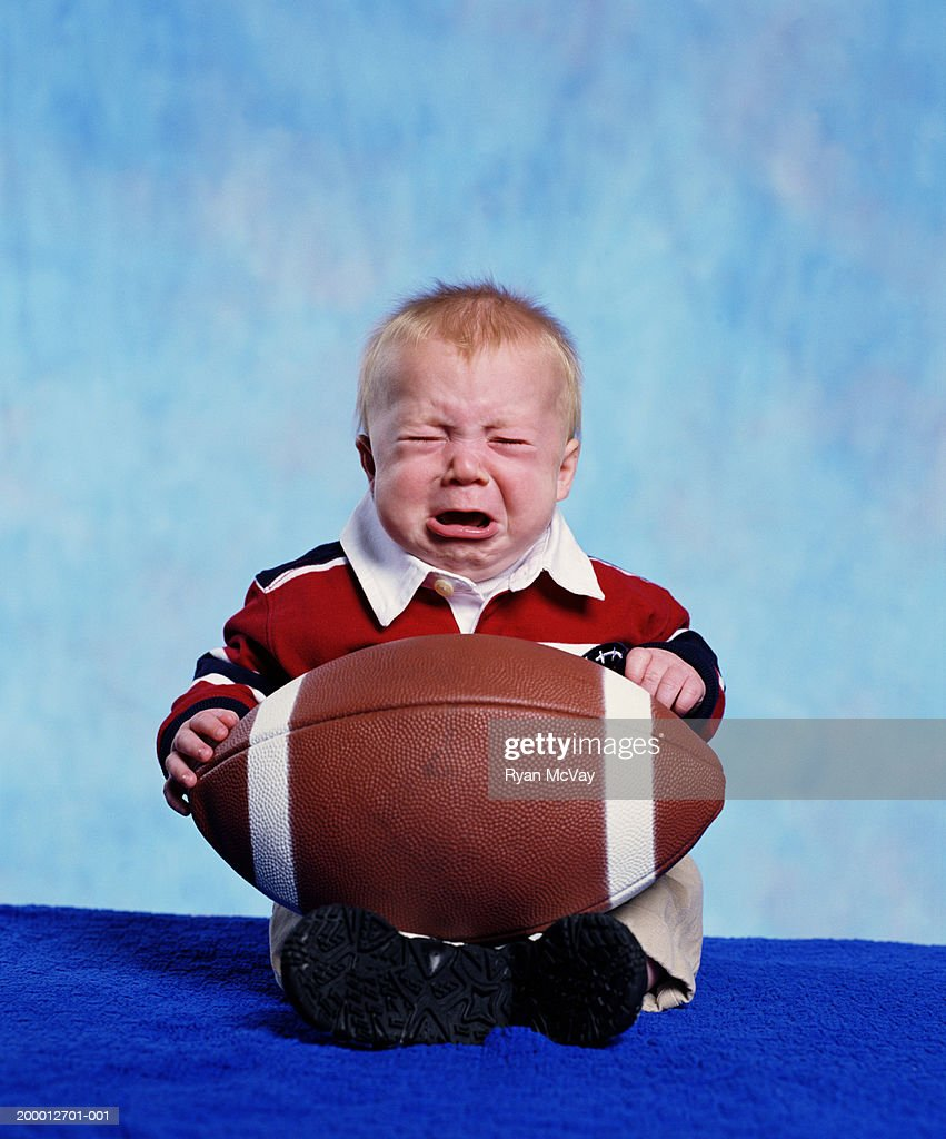Baby Boy Holding Football Crying Portrait High-Res Stock Photo - Getty  Images