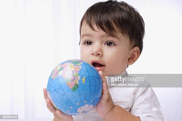 baby boy holding globe