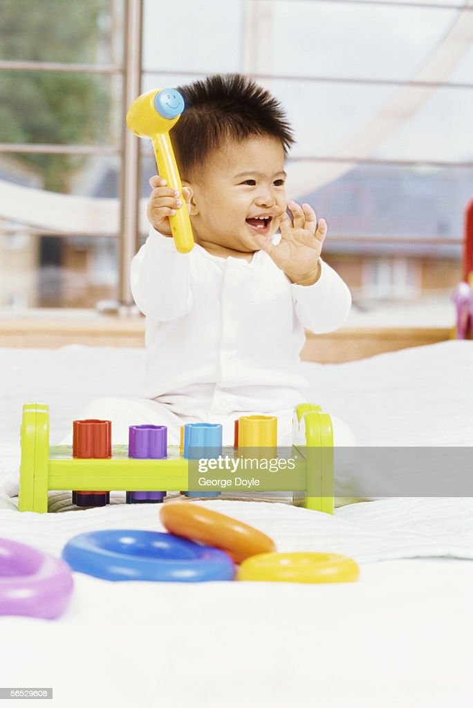 35ca2b16c Baby Boy Holding Up A Toy Hammer Stock Photo - Getty Images