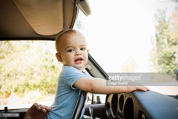 Baby boy in a car
