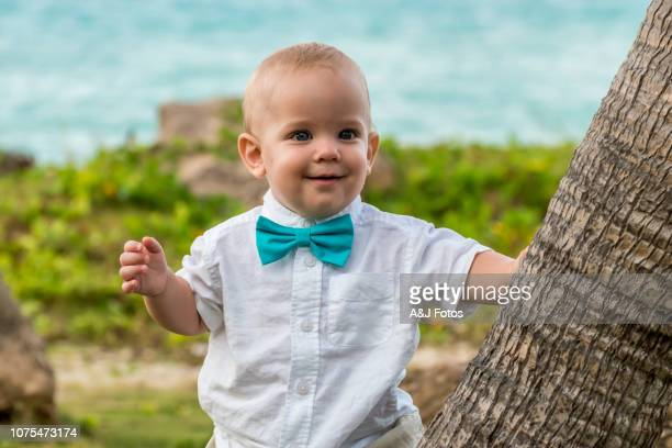baby boy in a wedding celebration - ceremony stock pictures, royalty-free photos & images