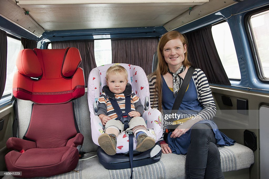 Baby boy in car seat with mother in back seat : Stock Photo