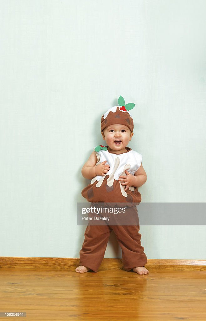 Christmas Pudding Outfit.Baby Boy In Christmas Pudding Outfit High Res Stock Photo