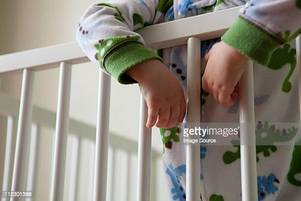 Baby boy in crib