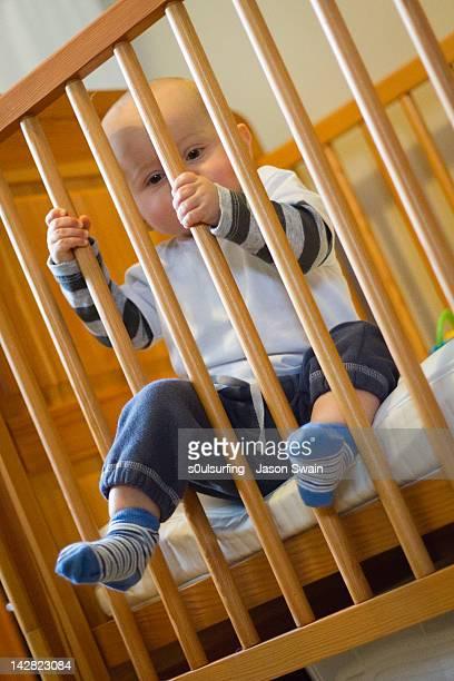 baby boy in his crib - s0ulsurfing ストックフォトと画像