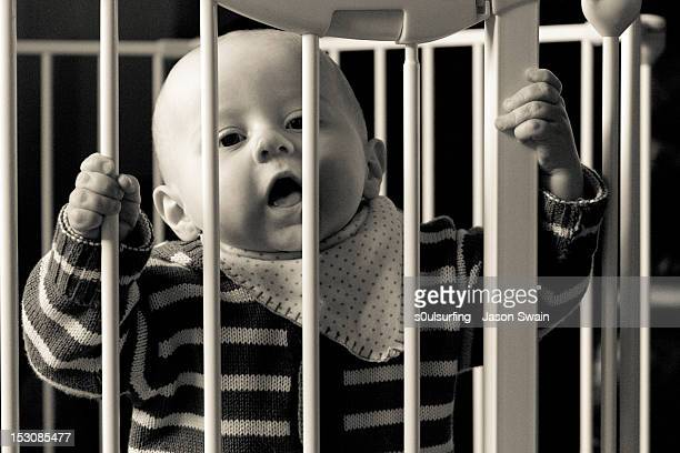 baby boy in his crib - s0ulsurfing stock pictures, royalty-free photos & images