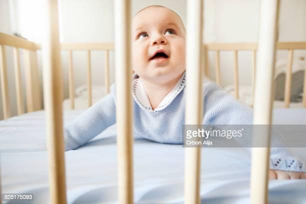 Baby boy in his crib