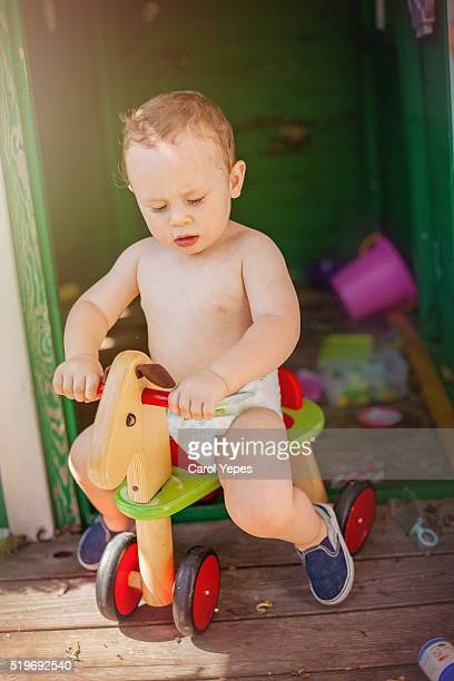 Baby boy in his rocking  horse