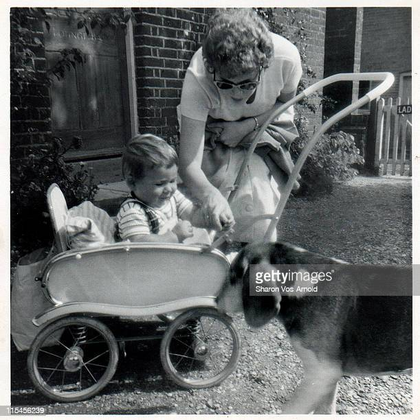 baby boy in pushchair with his mother - 1961 stock pictures, royalty-free photos & images