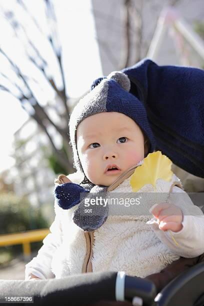 Baby boy in stroller,close up