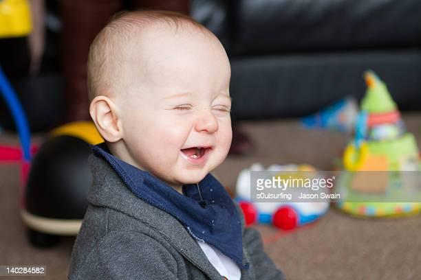 baby boy laughing - s0ulsurfing fotografías e imágenes de stock