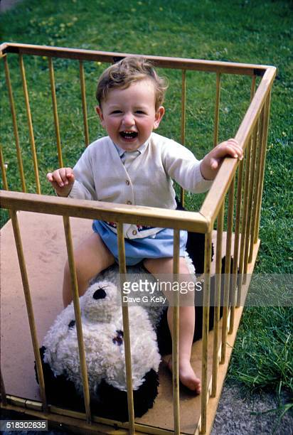 Baby Boy Laughing Sitting in a Playpen