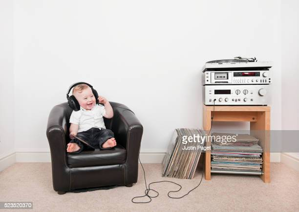 Baby boy listening to records