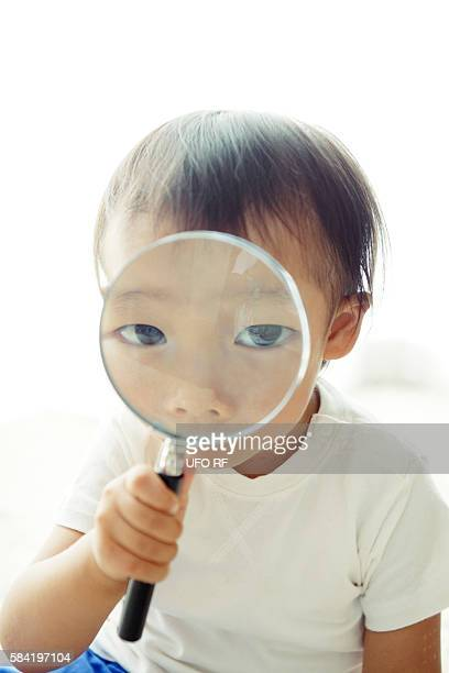 Baby Boy Looking Through Magnifying Glass