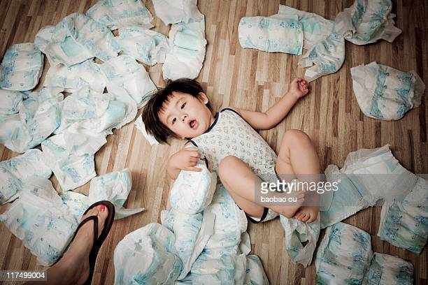 Baby boy lying with diapers