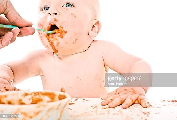 Baby Boy Making a Mess with Baby Food