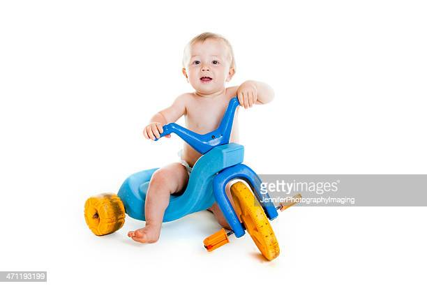 Baby Boy auf dem Dreirad