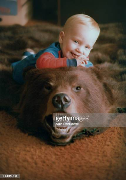 baby boy on bearskin rug - bearskin rug imagens e fotografias de stock