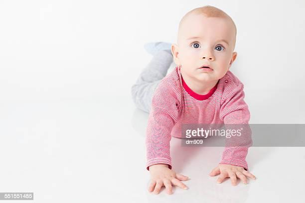baby boy on the ground - blaue augen stock-fotos und bilder