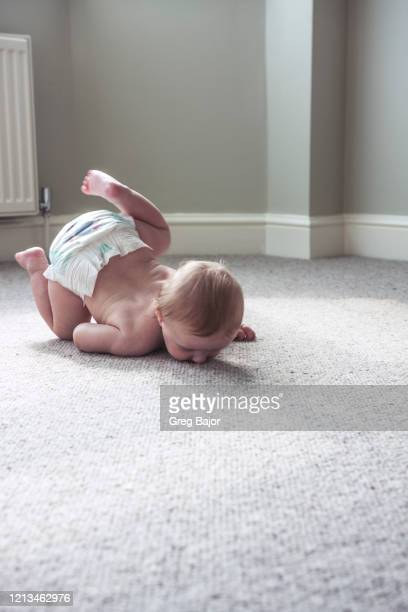baby boy - falling stock pictures, royalty-free photos & images