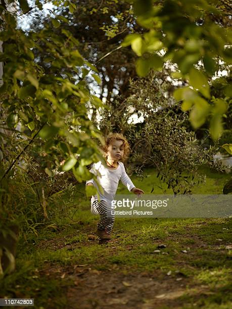 Baby Boy playing in the garden