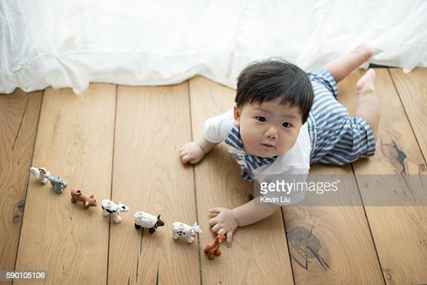 Baby boy playing on floor