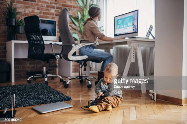 baby boy playing on the floor - businesswear stock pictures, royalty-free photos & images