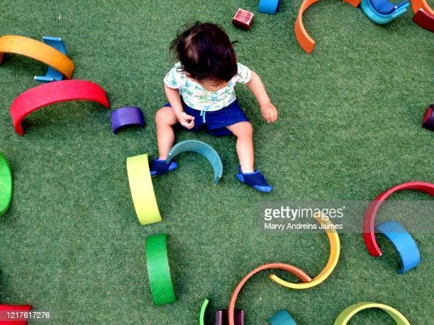 baby boy playing outdoors - 1歳以上2歳未満 ストックフォトと画像