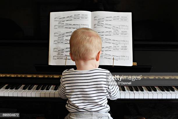 Baby boy playing the piano