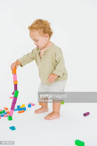 baby boy playing with blocks - 不均衡 ストックフォトと画像