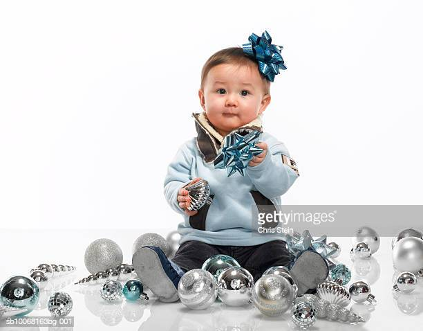 baby boy (6-11 months) playing with christmas ornaments, studio portrait - 6 11 months stock pictures, royalty-free photos & images