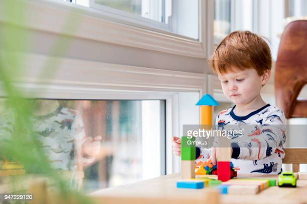 baby boy playing with colorful blocks - building blocks stock pictures, royalty-free photos & images