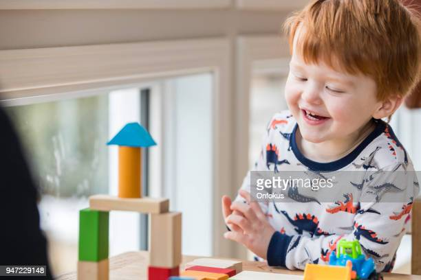 baby boy playing with colorful blocks - baby boys stock pictures, royalty-free photos & images