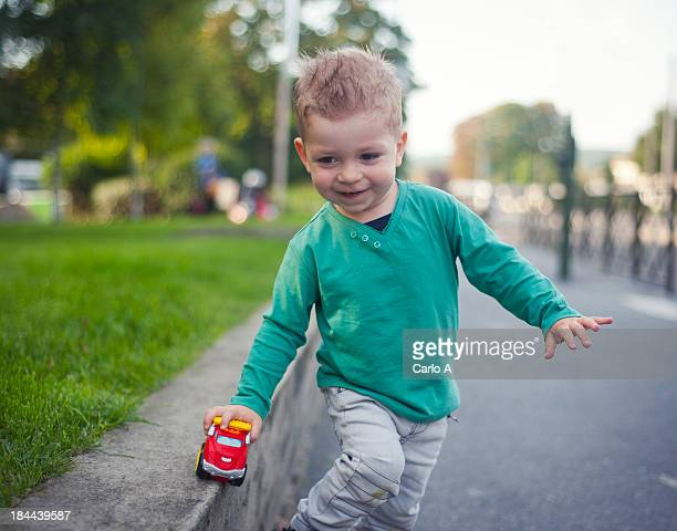Baby boy playing with toy car