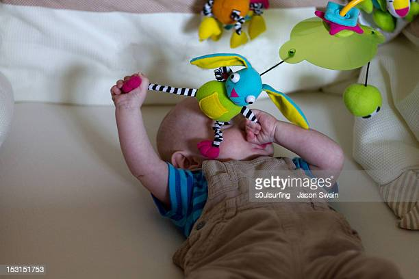 baby boy playing with toys - s0ulsurfing stock pictures, royalty-free photos & images