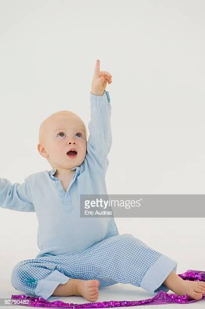 Baby boy pointing upward