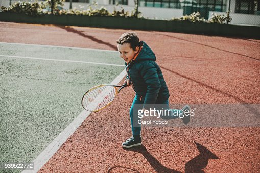 baby boy pretending to play tennis