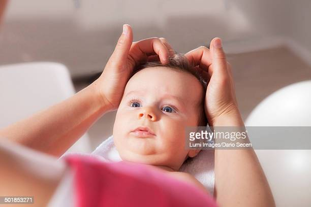 Baby boy receiving treatment from osteopath, Munich, Bavaria, Germany