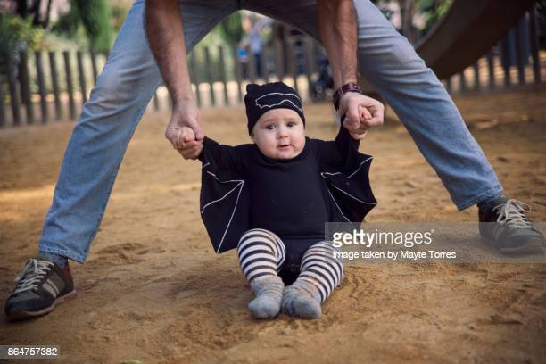 Baby boy showing off his bat wings at the playground